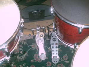 slave pedal next to main bass drum pedal
